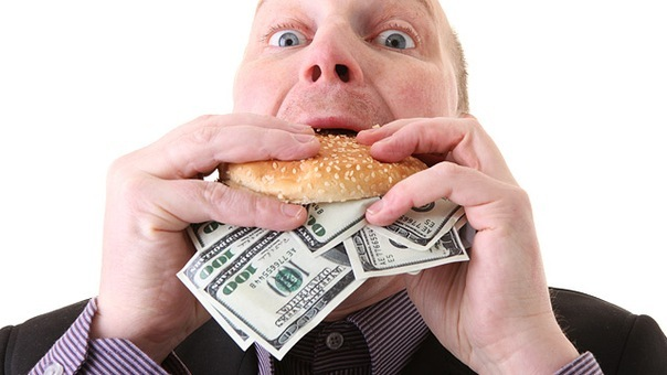 Алчный деловой человек phovoir images / фотобанк лори